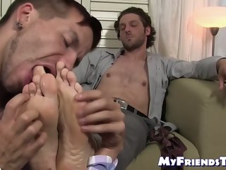 Hunky bearded dude feet worshiped and toe licked by gay stud